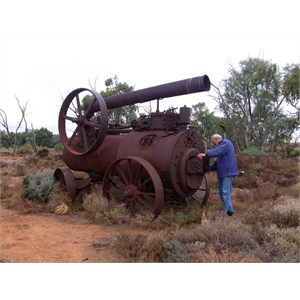 Old steam engine slowly rusting away.