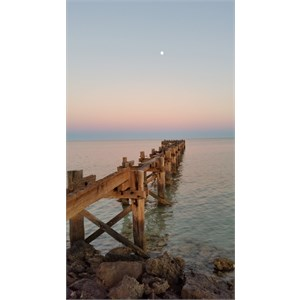 Sunrise with full moon over Gladstone Jetty