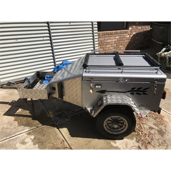 Motorcycle and camping trailer