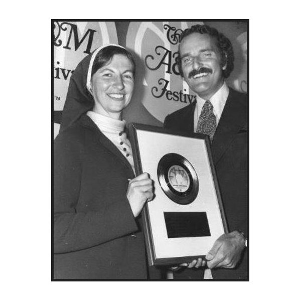 Sister Janet Mead receives her gold copy of The Lord's Prayer when it sold 1 million copies in the United States.