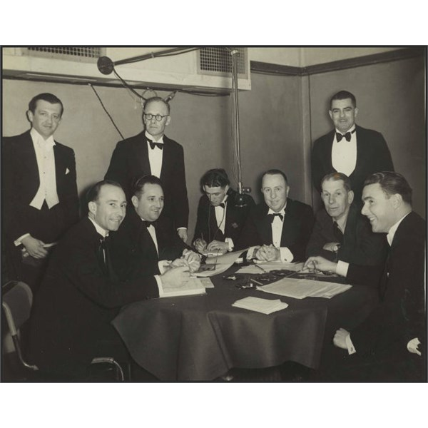 3AW test cricket broadcast, 1938. Seated 4th from left is Jack O'Hagan