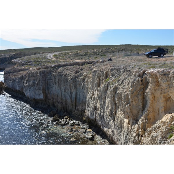 Shows you the fence line in relation to the cliff