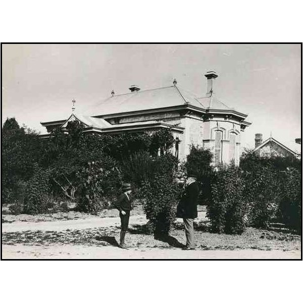 Warrakilla at Mylor, the owner, George Goyder (right) is seen in the garden 1895