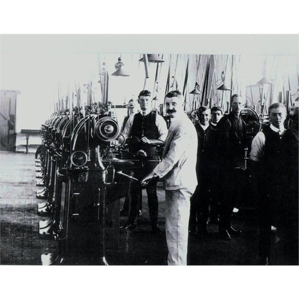 fitters & turners & supervisors preparing the laithes for production on the 303 rifles.
