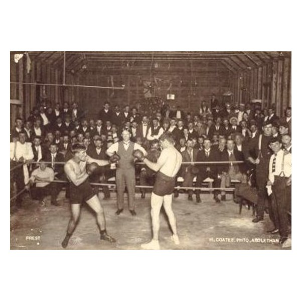 Jimmy Sharman Snr refereeing a boxing match in 1910