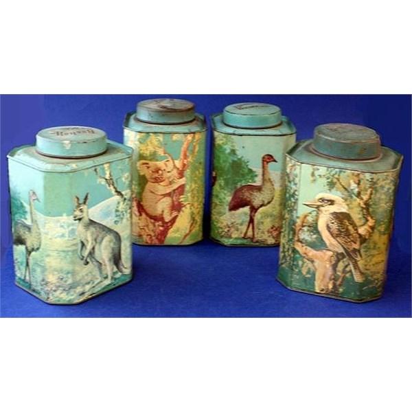 Collection of four Bushells tea tins