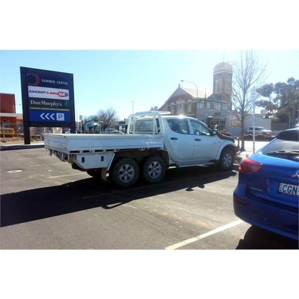 6 Wheeled Triton in IGA carpark