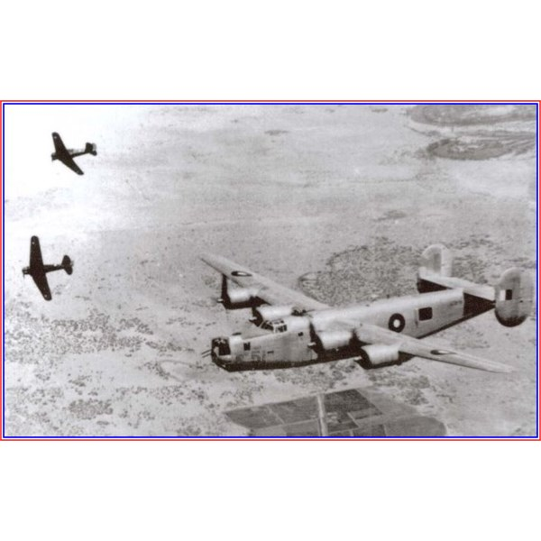 B24 A-72-51 in gunnery practice with a pair of Wirraways