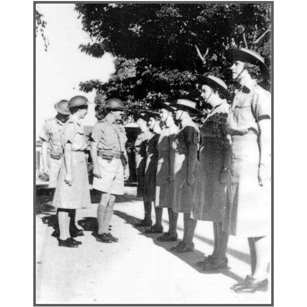 Inspection of some of the Townsville recruits on the tennis court at St. Anne's Barracks, in 1942.