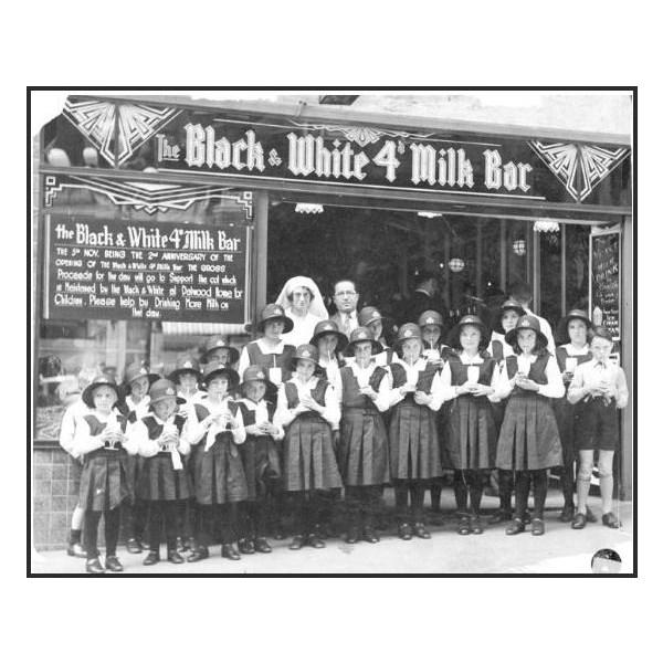 Schoolchildren outside the Black & White 4d. Milk Bar at Martin Place, Sydney, NSW, in 1934