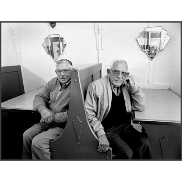 Peter and Jack Veneris sitting at a booth in the Blue