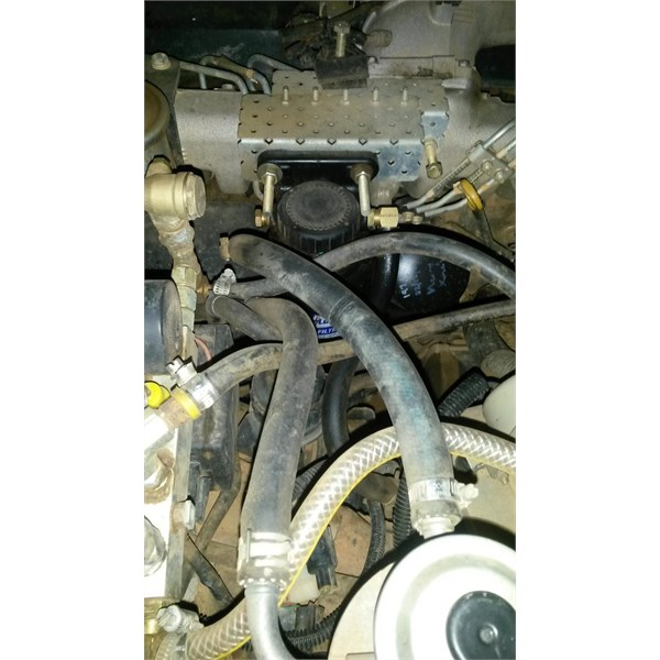 OEM filter bottom right. Right hose from Fuelmaster. Left hose to engine.