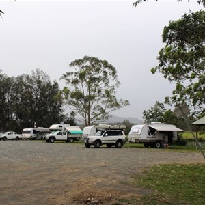 RVs parked along the river bank