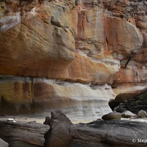 The art site is under the large ledge of this sandstone overhang