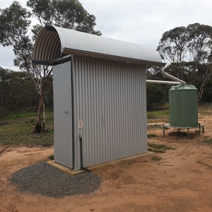 Toilet facility and small water tank