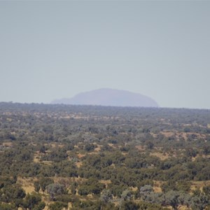 Ayers Rock as seen from top of Longs Range - 110 km distant