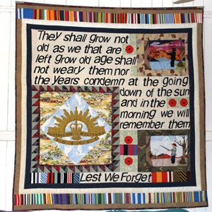 A remembrance tapestry hangs on a wall