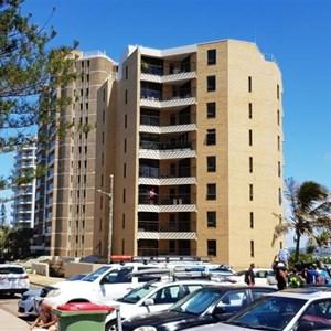 High rise apartment blocks overlook the car park