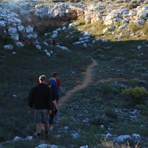 Walkers entering Knowles Cave area