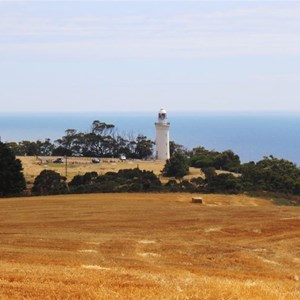 Table Cape lighthouse stands between 80 meter cliffs and rich agricultural land.