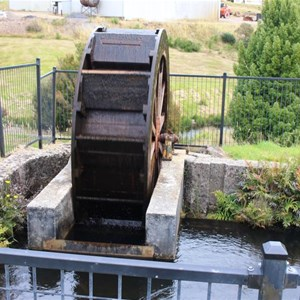 An original water wheel displayed driven by the water flow