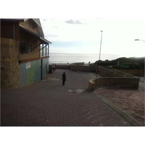 Walkway next to surf club towards beach