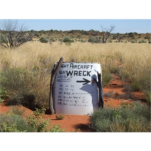 Sign written on aircraft wreckage - Anne Beadell Hwy WA
